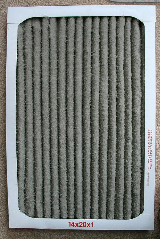 An air filter covered in dust and needs changing