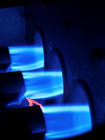 Propane burners warming the air as it prepares to circulate through the home.